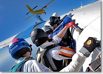 Skydivers wait for the signal to let go of the plane during a TSR training jump